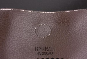 bad stiches on fake handbag