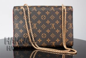 fake monogram bag with gold chain