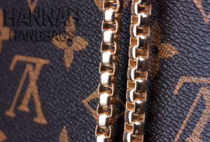 gold color chain handles of Louis Vuitton replica handbag